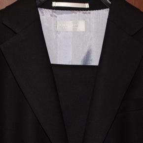 ベルリン出張2015春夏1-6「旅の持ち物とコナカのシャワークリーンスーツ」(コナカ Konaka のシャワークリーンスーツのジェケットの写真)【大移動準備(旧「ミニマリスト」)】